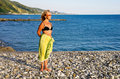 Woman stands on sea coast Royalty Free Stock Photography