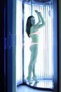 Woman stands in solarium and looks