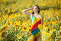 Woman stands on the yellow field of sunflowers. Royalty Free Stock Photo