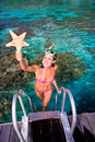 Woman starfish snorkel resort Stock Photography