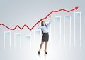 Woman with statistics curve business is trying to increase market Royalty Free Stock Images