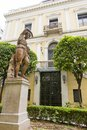 Woman statue and the entrance from Athens Numismatic Museum Royalty Free Stock Photo