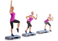 Woman step aerobics exercise Royalty Free Stock Photo