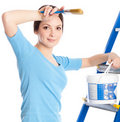 A woman on a stepladder Royalty Free Stock Photos