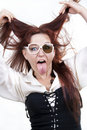 Woman sticking out her tongue Stock Photography