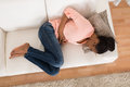 Woman With Stomach Ache Lying On Sofa Royalty Free Stock Photo