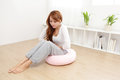Woman with stomach ache portrait of sitting on floor at home asian model Royalty Free Stock Images