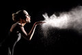 Woman with stop motion of explosive powder captured by flash beautiful Stock Images