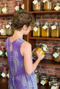 Woman in store shopping spices Royalty Free Stock Photography