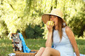 Woman in straw hat bite apple Stock Photos