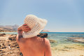 Woman with straw hat protects from sun Royalty Free Stock Photo
