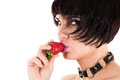 Woman with strawberry in mouth sexy portrait of a Royalty Free Stock Photography
