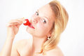 Woman with strawberry pretty finding pleasure in a Stock Photo