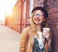 Woman in the street drinking coffee Royalty Free Stock Photo