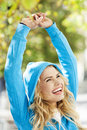 Woman stretches arms in park happy young standing outdoors Stock Images