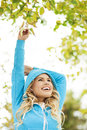 Woman stretches arms in park happy young standing outdoors Royalty Free Stock Images