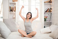 Woman stretching in bed after waking up, back view, entering a day happy and relaxed after good night sleep. Sweet dreams, good mo Royalty Free Stock Photo