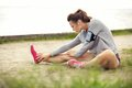 Woman stretching her legs before workout in sportswear outdoors running Royalty Free Stock Photography
