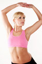 Woman stretching her muscles while exercising Royalty Free Stock Images