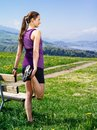 Woman stretching her muscles before running photo of a young leg she starts to run on a country path city and lake in the distance Stock Photos