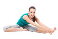 Woman stretching leg attractive young smiling over white background Stock Photography