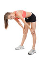 Woman stretching legs after jogging isolated Stock Image
