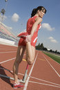 Woman Stretching On Racetrack Stock Photos