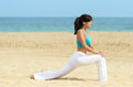 Woman stretching yoga on summer beach Royalty Free Stock Photo
