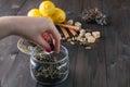 Woman strew herbal tea in glass jar Royalty Free Stock Image
