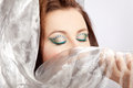 Woman with striking makeup conceals her face Royalty Free Stock Photo
