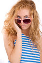 Woman in striped vest and pink glasses Stock Photo