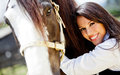 Woman stroking a horse Royalty Free Stock Photo