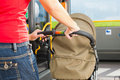 Woman with stroller getting into a bus Stock Images