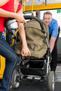 Woman with stroller getting into a bus Royalty Free Stock Image