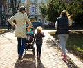 Woman with stroller walking along the street intentional motion blur Royalty Free Stock Image