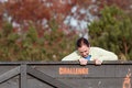 Woman struggles pulling herself over wall at obstacle course race buford ga usa november a young to climb a wooden the muddy brute Royalty Free Stock Photography