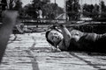 Woman struggling in mud run and obstacle course a participant the gladiator rock n event at the rose bowl pasadena competitors Stock Image