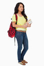 Woman student with backpack holding textbooks Stock Photos