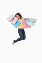Woman student jumping with shopping bags Stock Photo