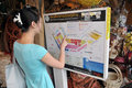 Woman Studies a Map at Chatuchak Market in Bangkok Royalty Free Stock Image