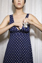 Woman stuffing bra. Stock Photo