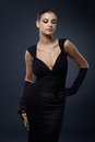 Woman in stylish black cocktail dress portrait of attractive and gloves Royalty Free Stock Photography