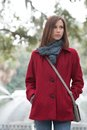 Woman in a stylish red coat brunette haired forsyth park Stock Photo