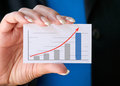 Woman with success business card hand of businesswoman upward trend graph on Stock Photos