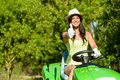 Woman success in field garden job successful and happy female gardener riding tractor doing approval gesture with thumbs up riding Stock Photography