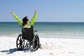 Woman successful disabled with arms raised celebrates her achievement and success in the sunshine even with her disabilities in a Royalty Free Stock Images