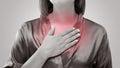Woman suffering from acid reflux or heartburn