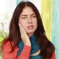 Woman suffering from tooth ache Stock Photos
