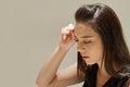 Woman suffers from headache, fatigue
