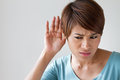Woman suffers from hearing impairment, hard of hearing Royalty Free Stock Photo